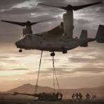 MV-22B lifts an M198 towed howitzer with a sling load. Photo: USMC