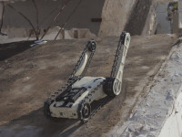 A ROBOT TEAM STANDS UP TO FIGHT IEDs