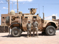 Soldiers from 2nd Brigade, 1st Armored Division, stand before a Warfighter Information Network-Tactical Increment 2 Point of Presence platform, May 17, 2012, during the WIN-T Increment 2 Initial Operational Test and Evaluation at White Sands Missile Range, N.M. Photo: Amy Walker, U.S. Army